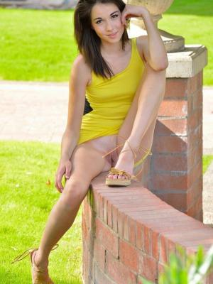 Emily Grey Sexy brunette takes off her yellow dress