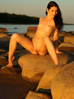 Nude beauty Olka teases in sexy poses on the beach